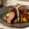 Roast loin of venison with butternut squash, girolles and roast Treviso